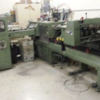 Muller Martini 6 Pocket Saddle Stitcher